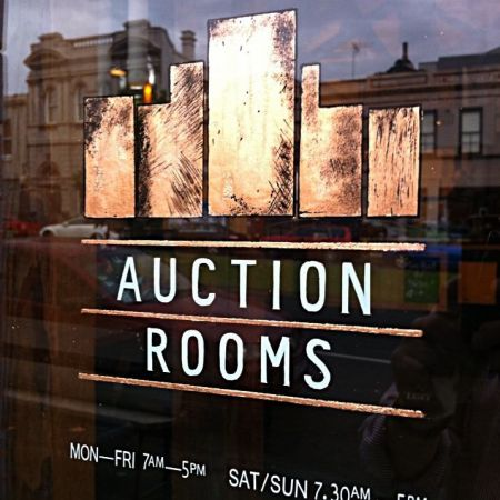 auction rooms reverse lettering and logo finished using copper leaf NthMelbourneVictoria sq