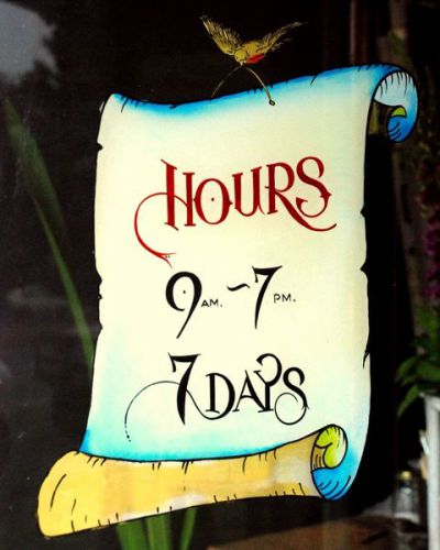 Image of custom/bespoke window signwriting project -  hand painted opening hours sign. A Day On Earth, Chapel Street, Prahran.
