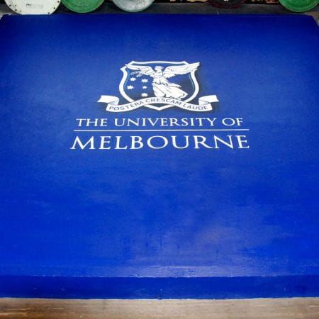 Hand painted logo on Melbourne University Power lifting platform
